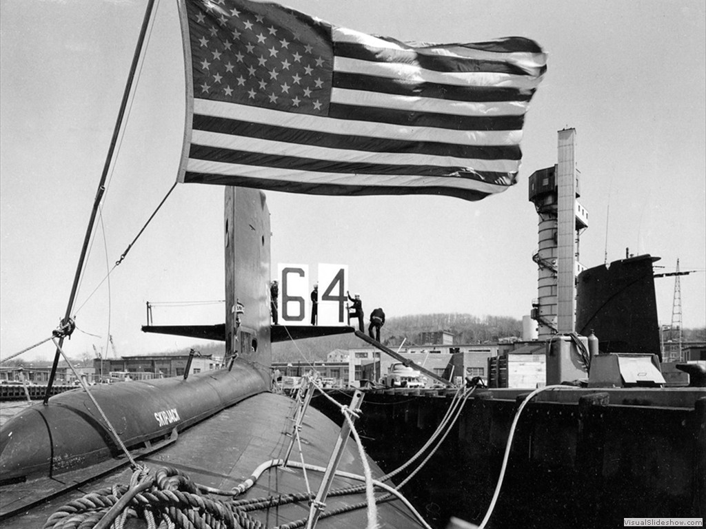 USS Skipjack (SSN-585) tied up to a pier at the submarine base, Groton, CT, 1964.